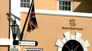 Stock Video Footage of British Flag outside Butterfield Bank