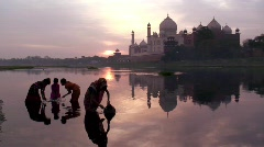 Mother collecting water, River Yamuna  nr Taj Mahal India Stock Footage