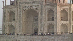 People walking around Taj Mahal ,at Sunrise Agra India Stock Footage