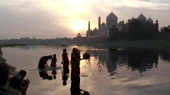 Mother collecting water, River Yamuna  nr Taj Mahal India Stock Footage