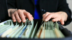 Woman searching through files Stock Footage