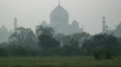 Women carrying water past the Taj Mahal, India - stock footage