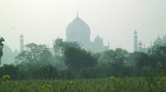 Women carrying water past the Taj Mahal, India Stock Footage