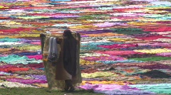 Drying Saris on banks of  River Yanuma, Agra India Stock Footage