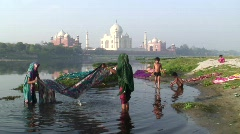 Women washing Saris in the river by Taj Mahal, Agra, India Stock Footage