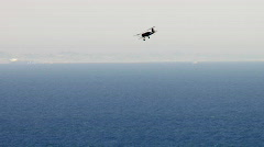 Bi-plane flying over Malibu beach - stock footage