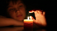 Girl and candle Stock Footage