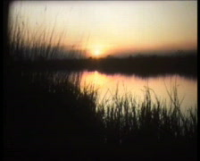 Retro Cine - Flickering Sunset Over Lake - stock footage
