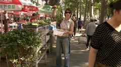 Woman in food market,china,beijing Stock Footage