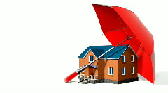 Red umbrella, protecting new private house Stock Footage