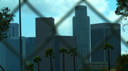 Stock Video Footage of Los Angeles Skyline / Fence 01