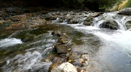 Running water among the rocks in the Carpathians Mountains Stock Footage