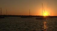 Sailboats in Harbor at Sunset - Pan Stock Footage