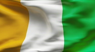 Stock Video Footage of creased satin  IVORY COAST flag in wind in slow motion