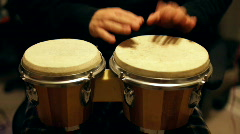 Hands playing bongos Stock Footage