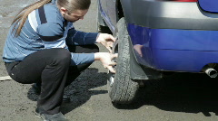 Young man changing the wheel - stock footage