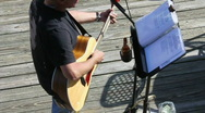 Acoustic Guitar Player With Sheet Music Stock Footage
