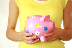 Hands shakes the piggy bank and showing thumb up sign Stock Footage