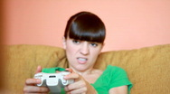 Dolly shot of young woman playing videogames, dolly shot  Stock Footage