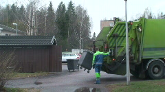 Man operates rubbish collecting machine one (720p) Stock Footage