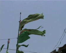 Flags and Market outside Shrine to Sufi Saint in Karachi, Pakistan - stock footage