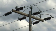 Power pole and clouds 2 Stock Footage