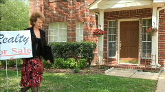 Realtor putting forsale sign in yard Stock Footage