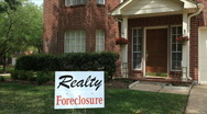 Stock Video Footage of foreclosure sign on house
