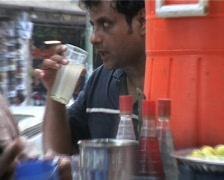 Man drink Sherbet from roadside Stall in Karachi, Pakistan Stock Footage