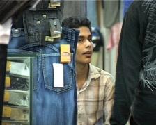 Market selling Fake Designer Clothes in Karachi, Pakistan Stock Footage