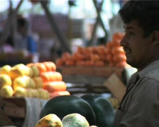 Shopkeeper cleaning fruits Stock Footage