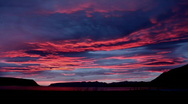 Psychedelic red glowing Mountain Sunset in the west fjords of Iceland hd Stock Footage