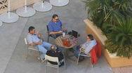 Stock Video Footage of Swimming pool and pool side - 4 - meeting of the minds in the shade