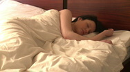 Stock Video Footage of Snoozing woman looking at alarm clock