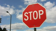 Stop sign. Timelapse clouds. Stock Footage