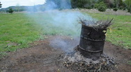 Stock Video Footage of Barrel with burning sticks