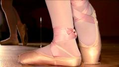 Young ballet dancers train in the gym and makes a graceful steps Stock Footage