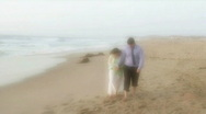 Man and Woman on Beach 3 Stock Footage