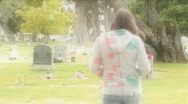 Stock Video Footage of Woman walks in graveyard