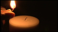 Stock Video Footage of HD - Lighting a Candle for a Vigil