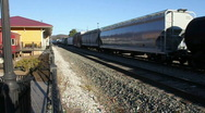 Cargo Train Passing By The Train Station Stock Footage
