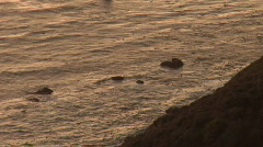 Looking Down Cliff at Ocean During Sunset Stock Footage