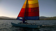 Stock Video Footage of Hobie Cat Sail Sunset Fly Flip 59.94