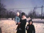 Family By Snow Sculptures (1969 Vintage 8mm film) Stock Footage