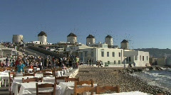Mykonos cafe and windmills - stock footage