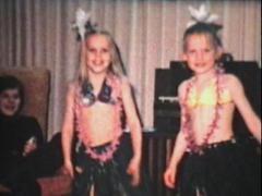 Girls Dancing With Hawaiian Skirts (1974 Vintage 8mm film) Stock Footage