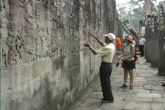 Angkor Cambodia Carved walls Bayon temple Stock Footage