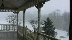 View of snow from a victorian style porch Stock Footage