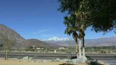 Anza Borrego palms, road and mountains Stock Footage