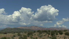 Arizona cumulus clouds over desert Stock Footage